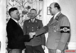 """Arthur Greiser welcoming the millionth resettler of German ethnicity during the """"Heim ins Reich"""" action from Central and Eastern Europe to occupied Poland - March 1944."""