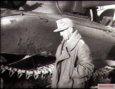 Major Johannes Kümmel inspecting the destroyed U.S. Sherman tank after the Battle of Kasserine Pass.