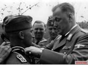 On behalf of der Führer Adolf Hitler, SA-Obergruppenführer Wilhelm Brückner awarded the Ritterkreuz des Eisernen Kreuzes to Oberfeldwebel Josef Portsteffen. Watching from behind are, from left to right: SS-Gruppenführer Julius Schaub and SS-Gruppenführer und Generalleutnant der Waffen-SS Karl Wolff.
