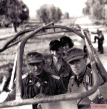 The front seat of the Sd.Kfz. 251/3 mittlerer Funkpanzerwagen, from left to right: Oberst Hans Christern and Oberstleutnant im Generalstab Peter Sauerbruch.The picture was taken in Kurland pocket in 1944.