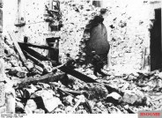 German paratroopers in action among the rubble of Cassino.