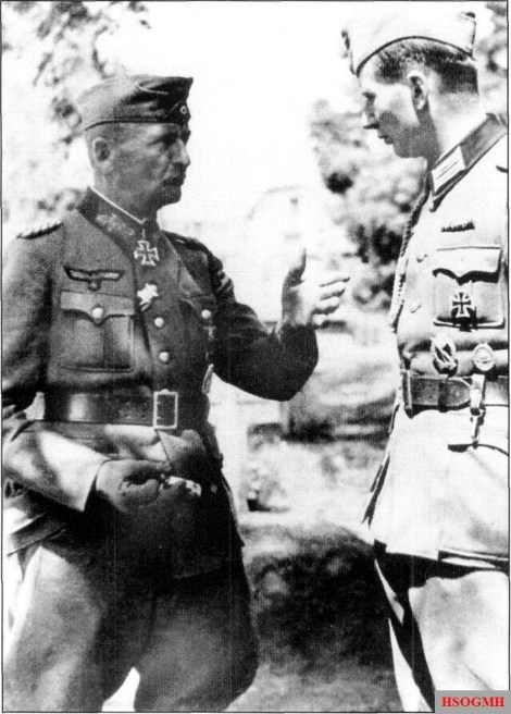 Generalmajor Karl Arndt (left) chatting with another Heer officer.