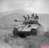 British officers ride on a captured Panther tank in Italy June 1944, with early letterbox hull gun aperture.