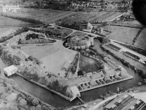 An aerial view over Fort Rowner in 1925 with the church beyond