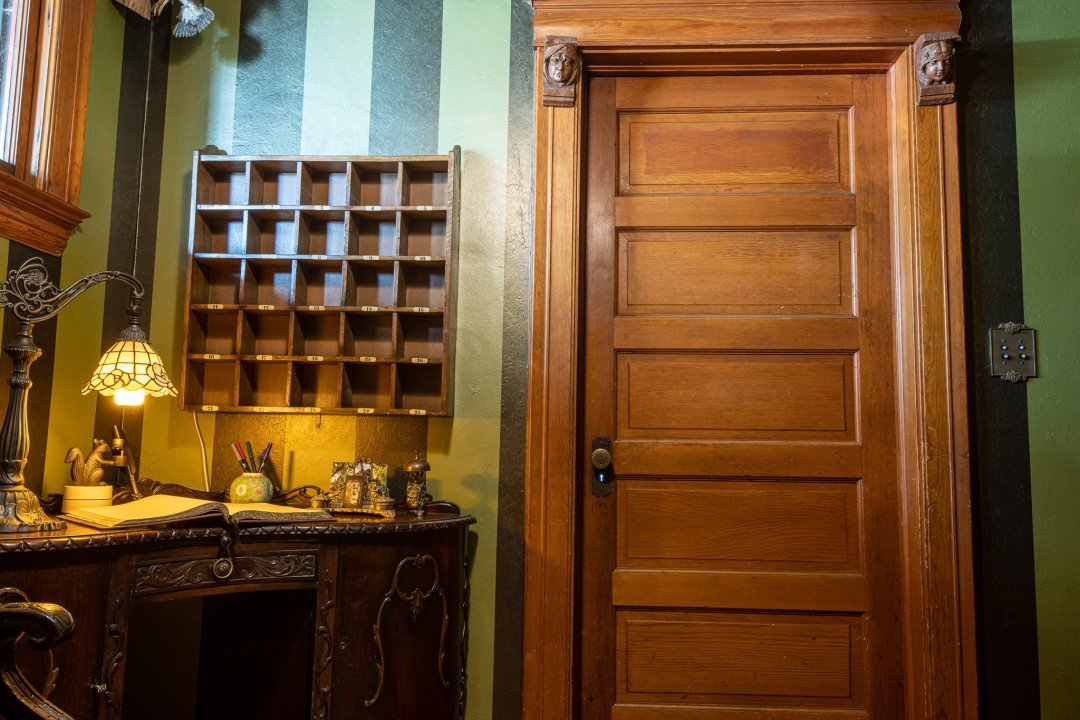Taxidermy and a mail slot in the front entryway of the Harris House