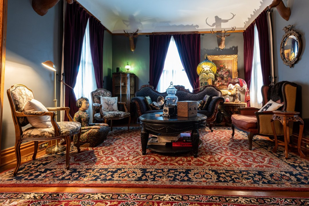 The Rear Parlor (Living Room) with Wooden Animal Heads and Curiosities