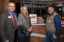 Tom Hoby (left), Jeffco Open Space director, joins Sheila and Randy Rooney in admiring the landmark certificate and plaque for the Colorow Ute Council Tree and Rooney Ranch Picnic Site, now part of Matthews-Winters Park. Photo by Matthew Lewis.