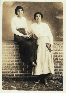 Two Women on Brick Wall