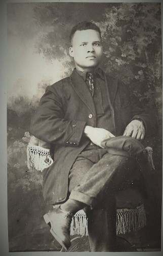 Youth with Cap on Lap