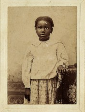 Little Girl Standing with Hand on Table