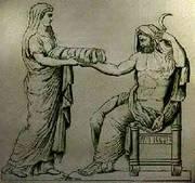 Rhea biedt haar man de in doek gewikkelde steen aan