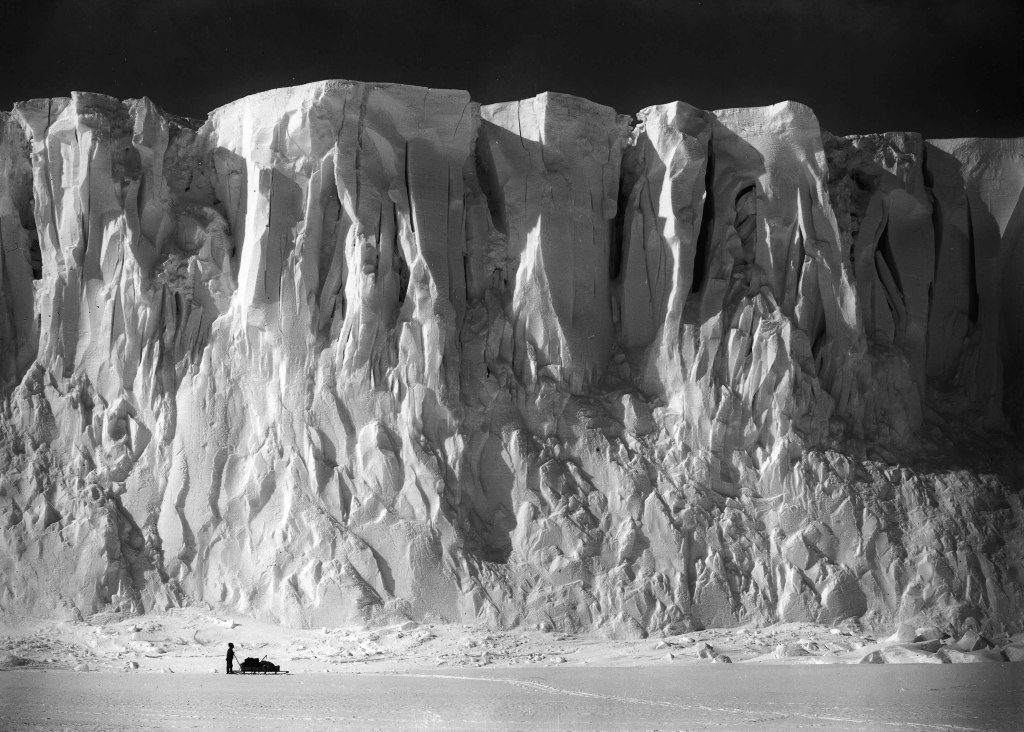 H.G Ponting. Captain Scott+s Antarctic Expedition 1910 - 1912. 2nd December, 1911. The ice cliffs at the end of the Barne Glacier with Mount Erebus in the background.
