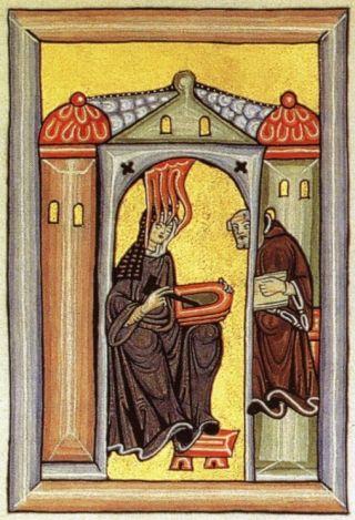Hildegard van Bingen schrijft haar visioenen neer op wastabletten.