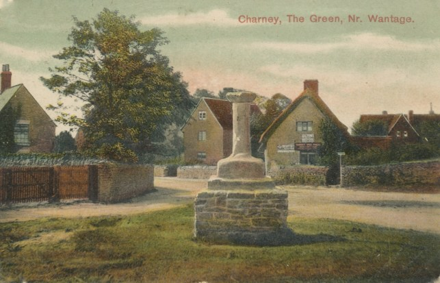 Village Cross and Shop. Colour Postcard.