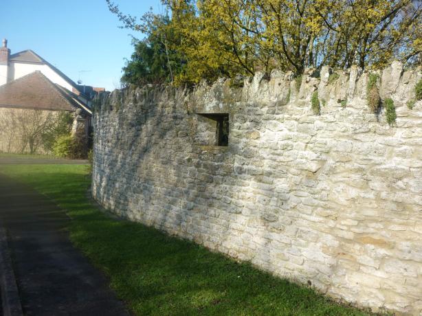 Machine gun loop-hole [in Manor garden wall]