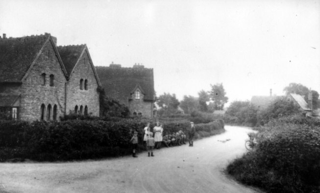 Children with School in background (right)