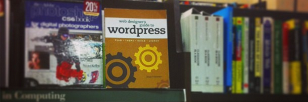 Photo of Web Designers Guide to WordPress by Jesse Friedman on a shelf in a bookstore