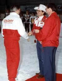 Committee Member Erik Laerz presents a gold medal to fellow committee member and Junior Coach Gerry Preuter.