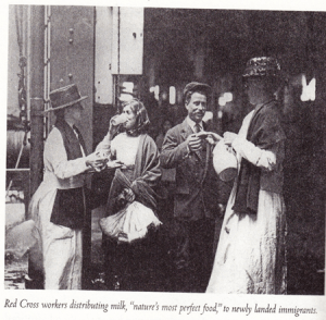 """Red Cross Workers Distributing Milk, """"Nature's Most Perfect Food"""", To Newly Landed Immigrants"""