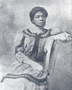 historic photo of Black woman in white dress