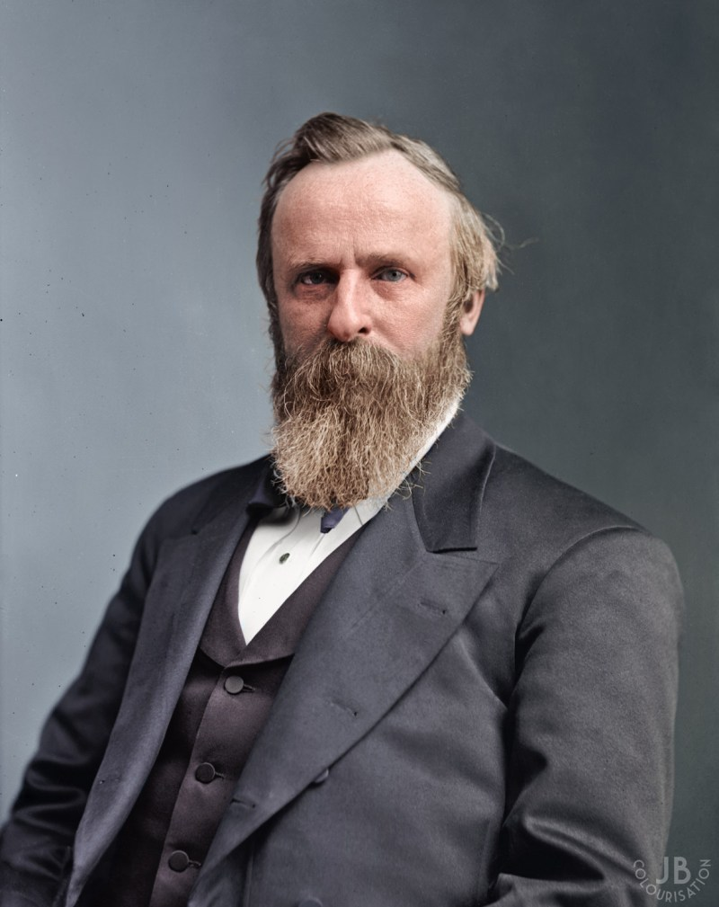 President Rutherford B. Hayes looking at the camera. He is wearing a suit and is in color.
