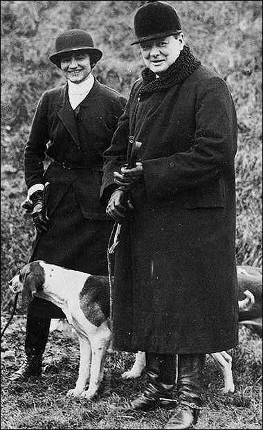 Winston Churchill and Coco Chanel with a dog photographed in the 1920s.