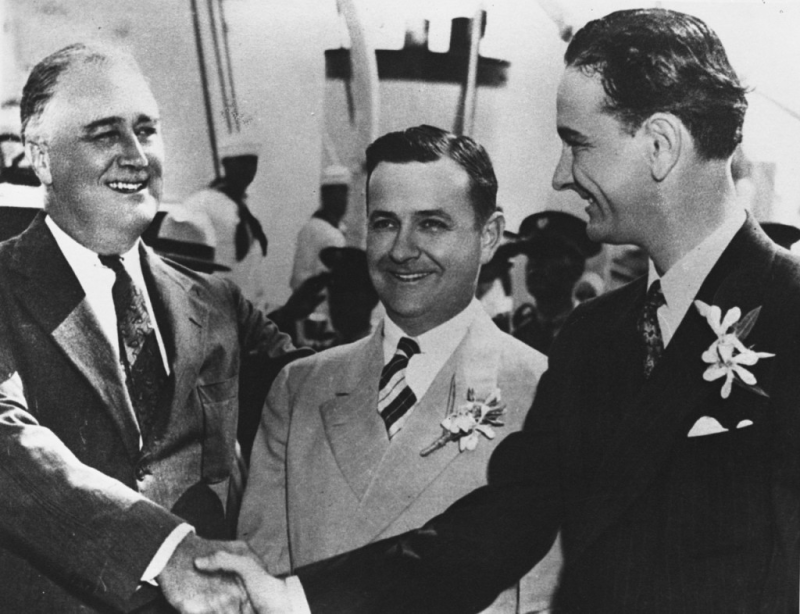 President Franklin D. Roosevelt shaking hands with a young Lyndon Johnson in 1937.