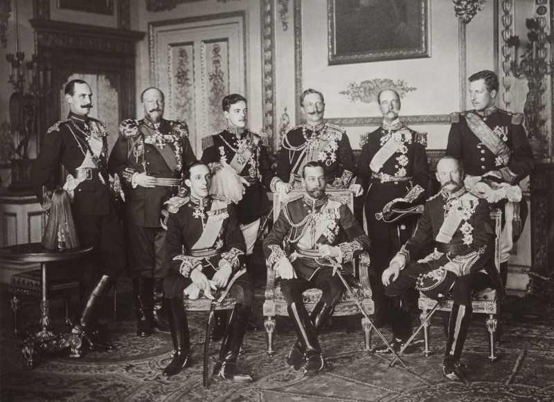 Photograph of 9 monarchs together in military uniform in a fancy room in Windsor Castle in May 1910. Standing, from left to right: Haakon VII of Norway, Ferdinand of Bulgaria, Manuel II of Portugal, Wilhelm II of Germany, George I of Greece, and Albert I of Belgium. Seated, from left to right: Alfonso XIII of Spain, George V of the United Kingdom, and Frederick VIII of Denmark.