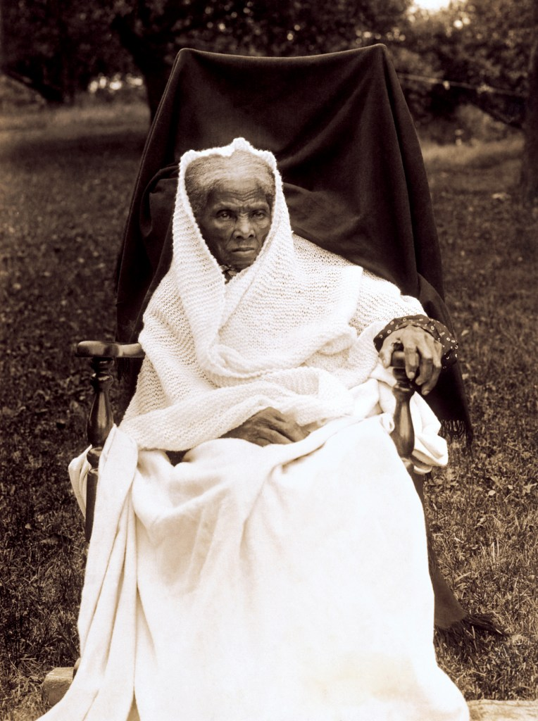 Harriet Tubman at the age of 89 in 1911 sitting on a chair.