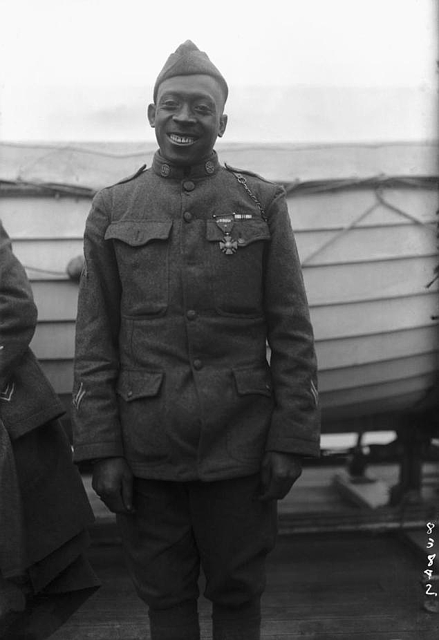 "Sergeant William Henry ""Black Death"" Johnson of the 369th Infantry Regiment (Harlem Hellfighters) wearing his Croix de Guerre medal in circa 1918."