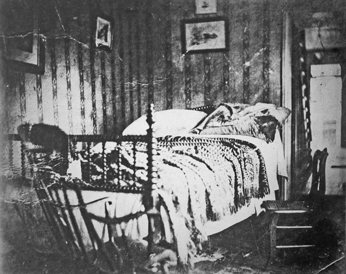 The room in which Abraham Lincoln laid dead. He was brought to this room across from the theater where he was shot in the head. This photo shows the deathbed of Abraham Lincoln shortly after his body was moved. April 1865.