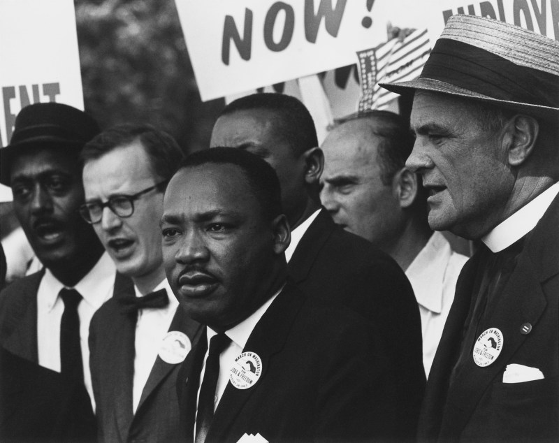 Historical photograph of Martin Luther King jr. in a suit during the March on Washington in august 1963.