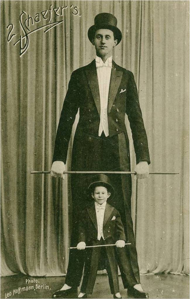 The world tallest man, Jakob Nacken in a tuxedo and top hat posing for a photograph with a small boy also wearing a tuxedo and top hat for the circus in 1924. Nacken went on to become the tallest soldier in the German Army and World War 2