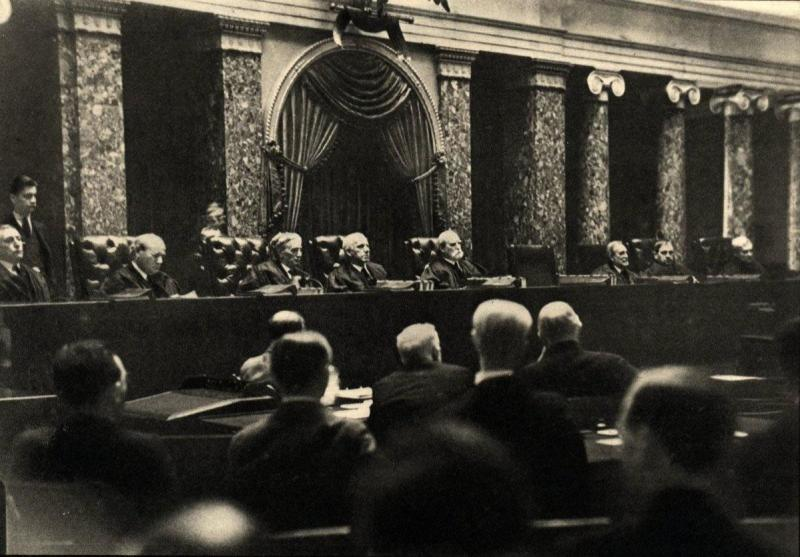One of only two photos that exist of the US Supreme Court in session, photographer Erich Salomon pretended to have a broken arm, and hid a camera in his cast to take this image. It is illegal for cameras to be in the courtroom while the US Supreme Court is in session. This was taken in 1932 during the Hughes Court.