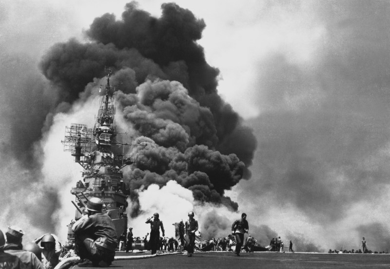 Scene on the USS Bunker hill on fire after it was hit by Kamikazes in May 1945.