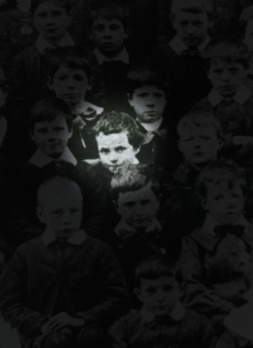 Charlie Chaplin as a 7 year old boy within a school photo alongside other children.