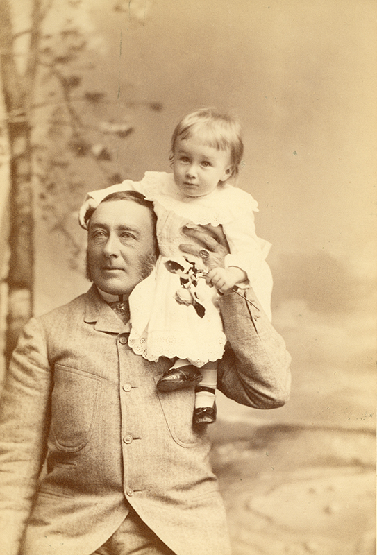 Franklin D. Roosevelt at the age of 16 months sitting on his fathers shoulder.