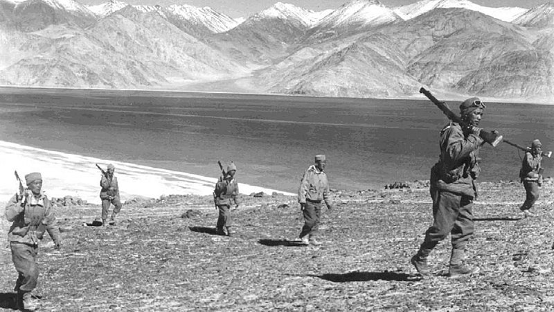 Rifle-toting Indian soldiers on patrol during the brief, bloody 1962 Sino-Indian border war.