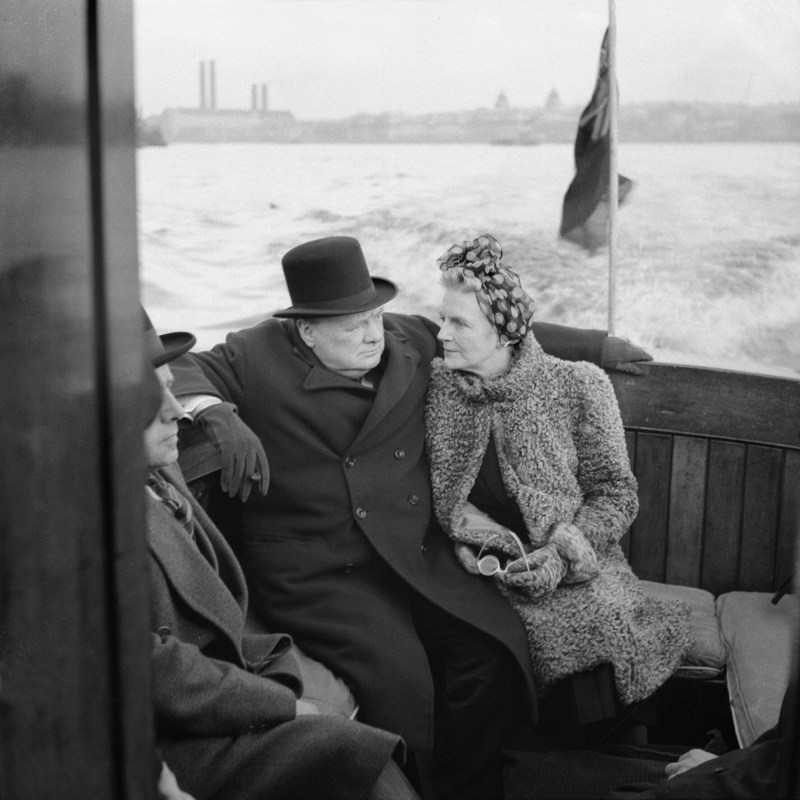 Winston Churchill and Clementine Churchill sitting on a boat close together. September 1940.