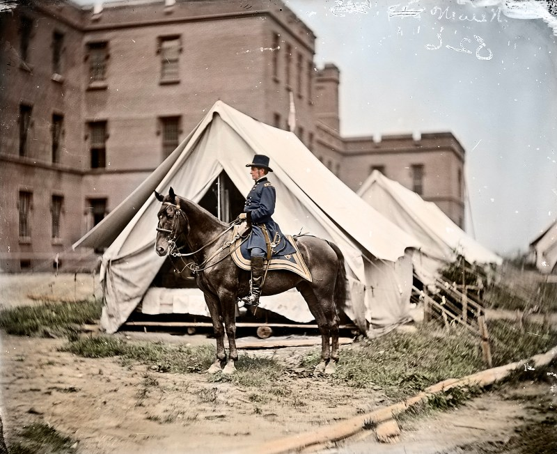 Colorized photograph of American Civil War Union Army Soldier, Joseph Hooker, wearing military uniform sitting on a horse in 1863.