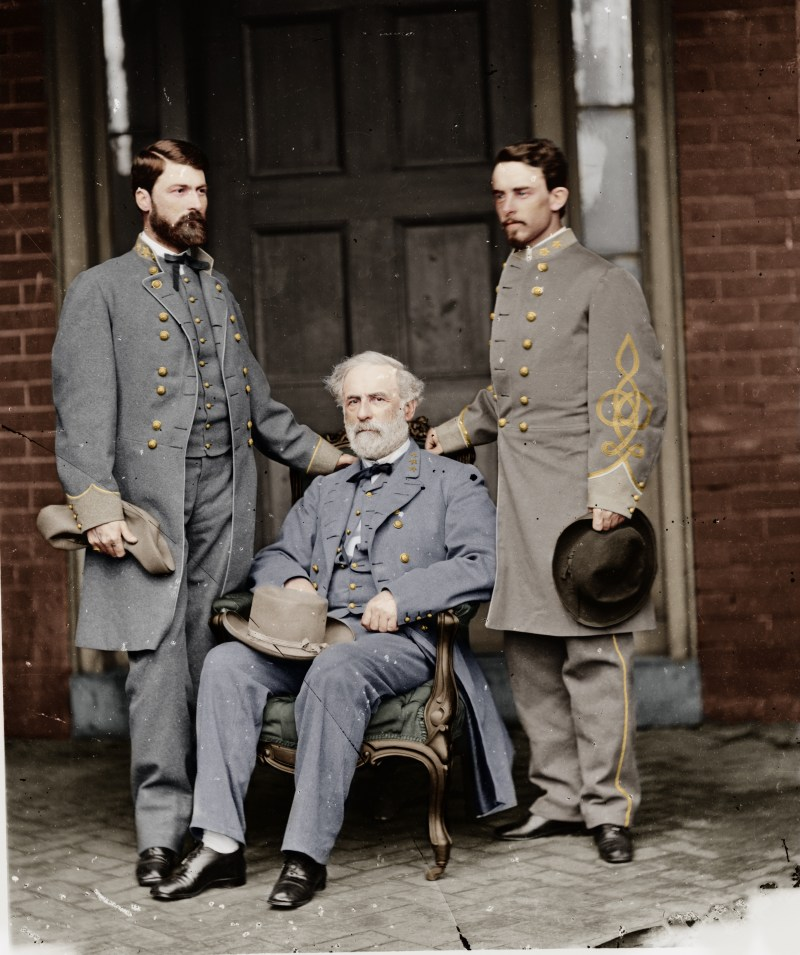 Commander of the Confederate Army, Robert E. Lee (seated), photographed with his son, George Washington Curtis Lee (left), and his chief aide, Walter H. Taylor (right). April 16, 1865. Colorized.