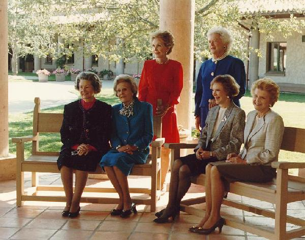 First Ladies Lady Bird Johnson, Pat Nixon, Rosalynn Carter, Betty Ford (front row, left to right), Nancy Reagan, and Barbara Bush (standing, left to right) at the dedication of the Ronald Reagan Presidential Library, 4 November 1991.