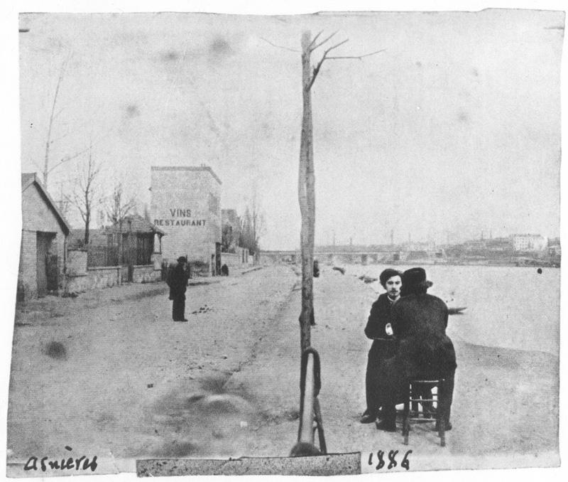 Vincent Van Gogh sitting with fellow artist Emile Bernard