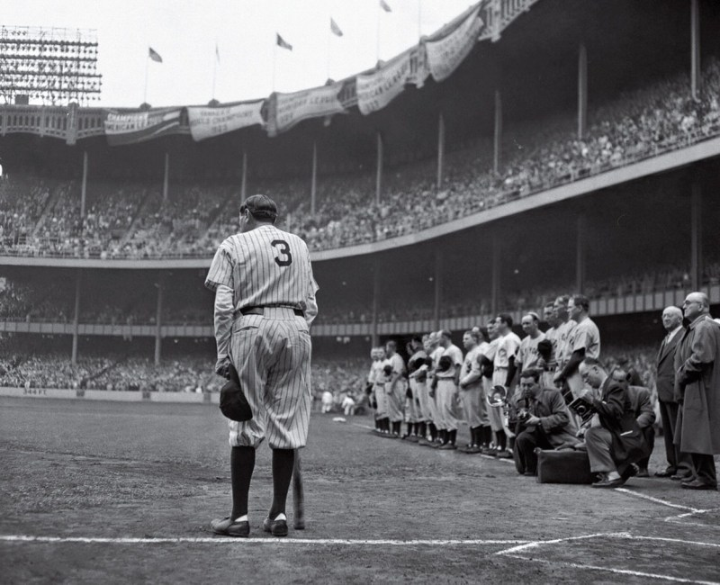 """The 1949 Pulitzer Prize-winning photo """"Babe Ruth Bows Out"""" showing Babe Ruth during his final public appearance at a ceremony at Yankee Stadium to retire his number."""