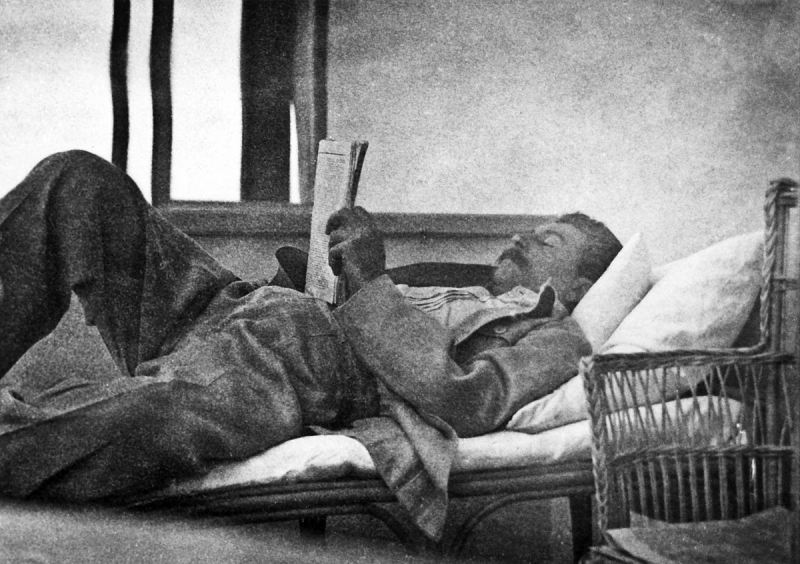 Joseph Stalin reading newspapers, from the archives of Evgeny Kovalenko. 1920