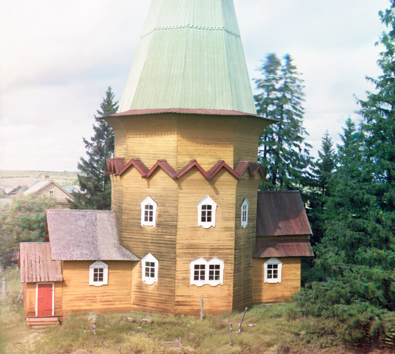 Yellow wooden church in Pid'ma, Russia