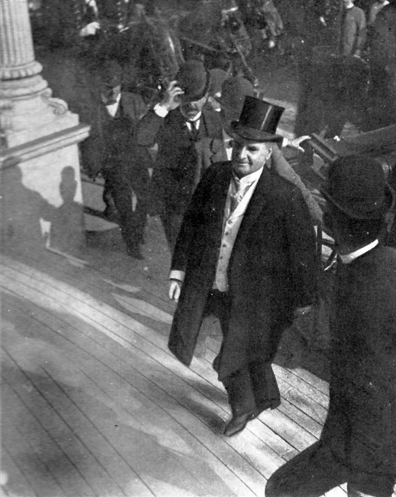 President William McKinley in a suit walking up stairs in what would be his last photo.
