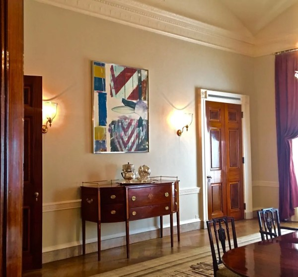 Modern American Art featured in a secondary dining room