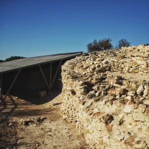 One of the stonewalls at Choirokoitia. The roof covers active archeological research.