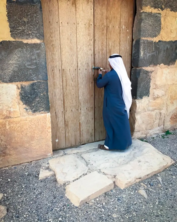 My guide at Quseir Amra opening up the doors